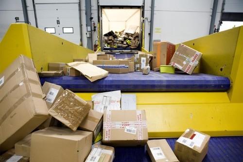 Los uw pakketten in enkele minuten Ancra Systems - Schakelband systeem